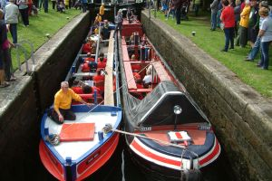 Working boats carrying the band in Langley Bridge lock
