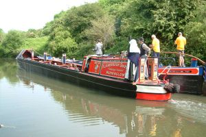 Working boats carrying the band towards Langley Bridge lock