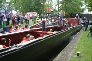 Working boats carrying the band lockside image